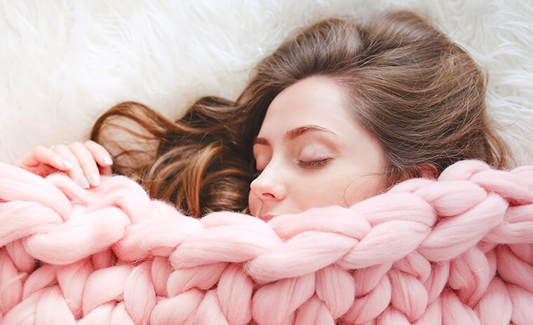 woman sleeping with a blanket covering her